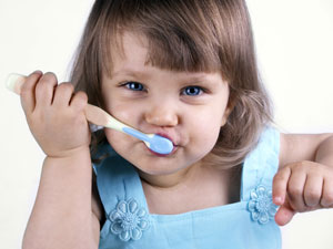 Girl Brushing Teeth.